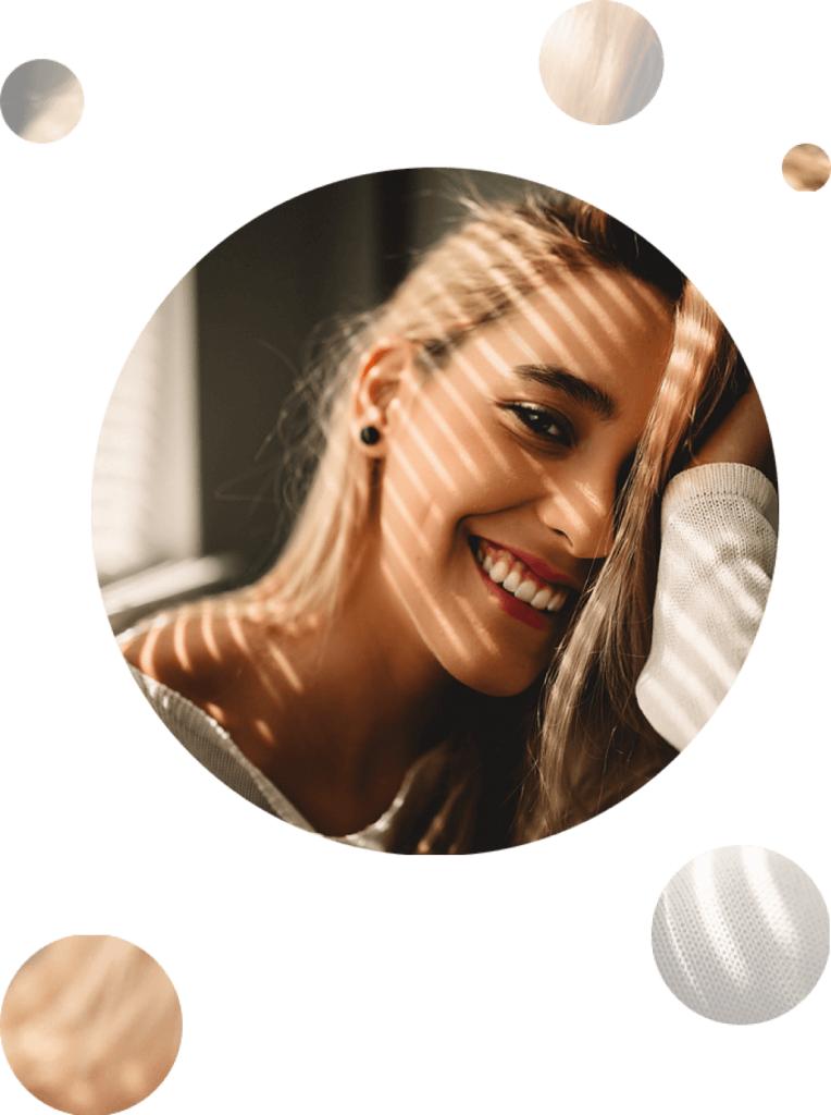 Young blonde girl with eyelashes extensions happily smiling