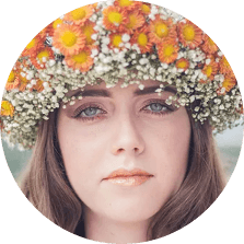 Girl with long hair and classic eyelashes extension wearing a flower crown